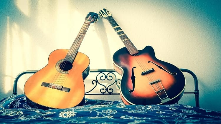 poster of acoustic and electric guitar
