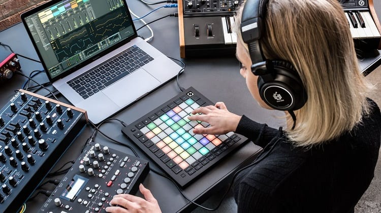Woman Using Novation Launchpad